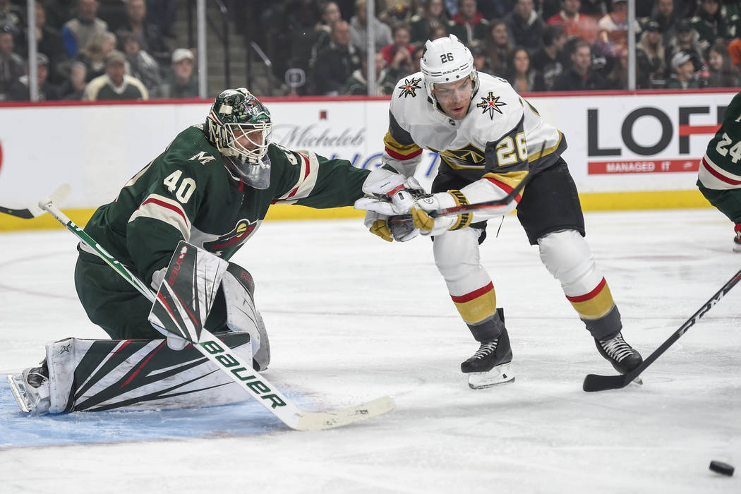 Minnesota Wild goalie Devan Dubnyk (40) pushes off Vegas Golden Knights forward Paul Stastny (26) in the first period during an NHL hockey game Saturday, Oct. 6, 2018, in St. Paul, Minn. (AP Photo ...