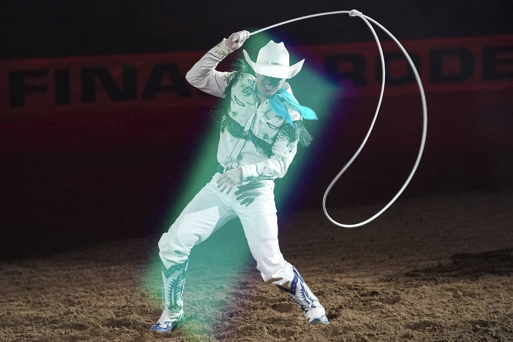 Trick roper Rider Kiesner entertains the crowd during the eighth go-round of the National Finals Rodeo at the Thomas & Mack Center in Las Vegas on Thursday, Dec. 13, 2018. Richard Brian Las Ve ...