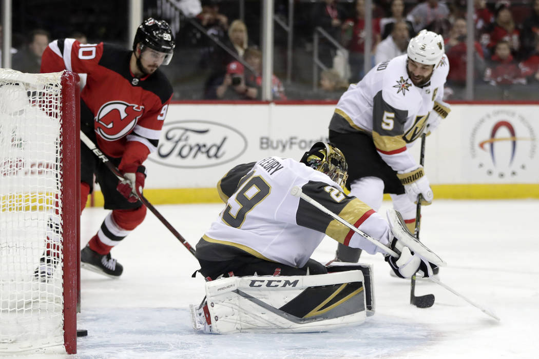A shot by New Jersey Devils center Travis Zajac, not pictured, gets by Vegas Golden Knights goaltender Marc-Andre Fleury (29) for a goal during the second period of an NHL hockey game, Friday, Dec ...