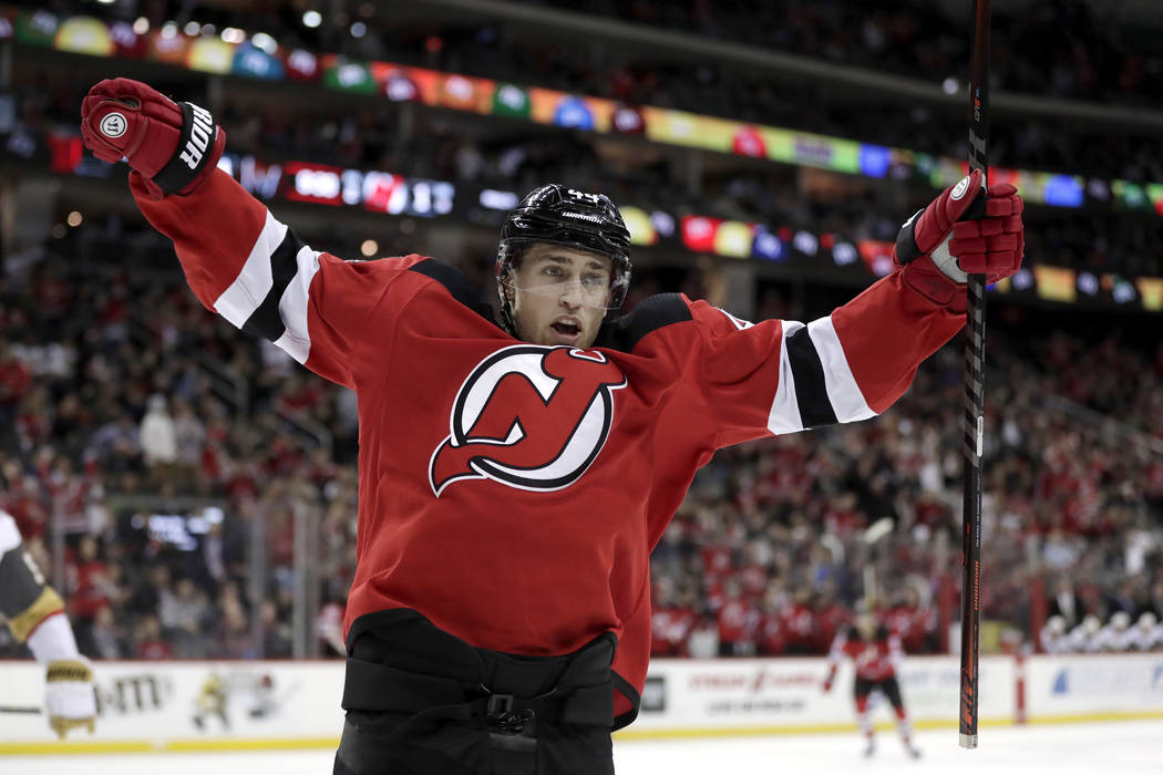 New Jersey Devils left wing Miles Wood reacts after scoring a goal against the Vegas Golden Knights during the second period of an NHL hockey game, Friday, Dec. 14, 2018, in Newark. (AP Photo/Juli ...
