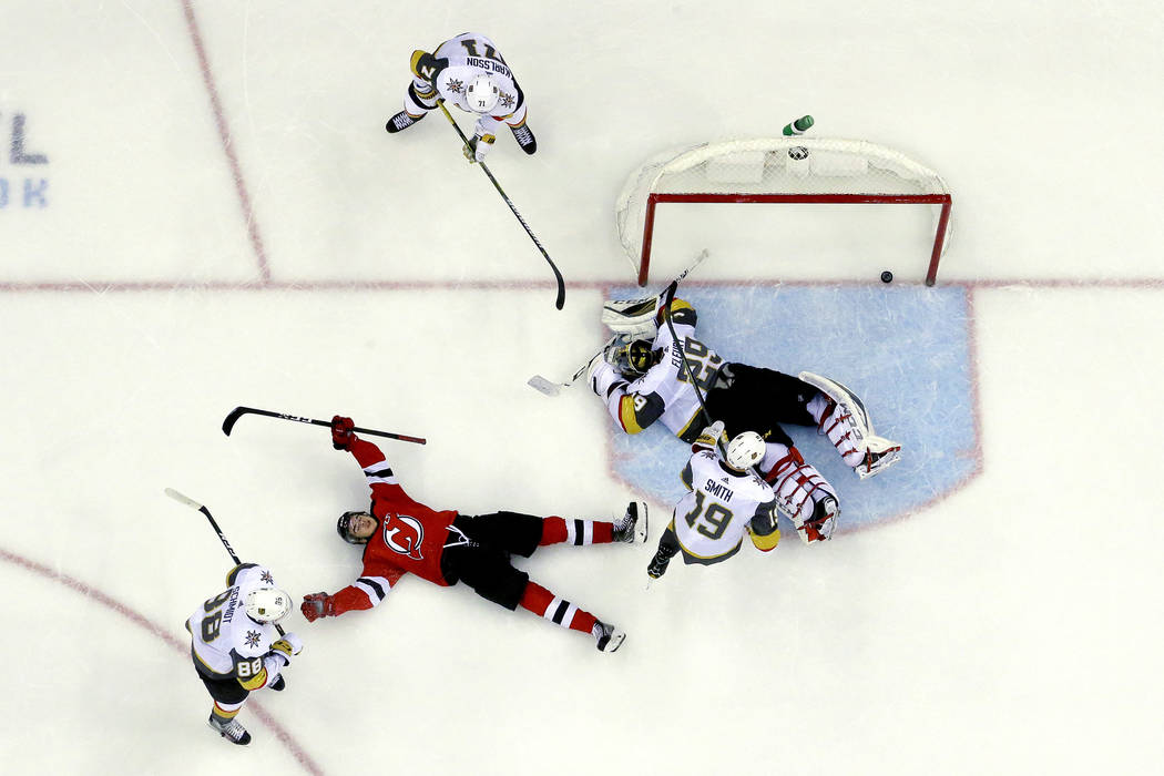 New Jersey Devils center Nico Hischier, second from left, of Switzerland, celebrates after scoring the winning goal against Vegas Golden Knights goaltender Marc-Andre Fleury (29) during overtime o ...