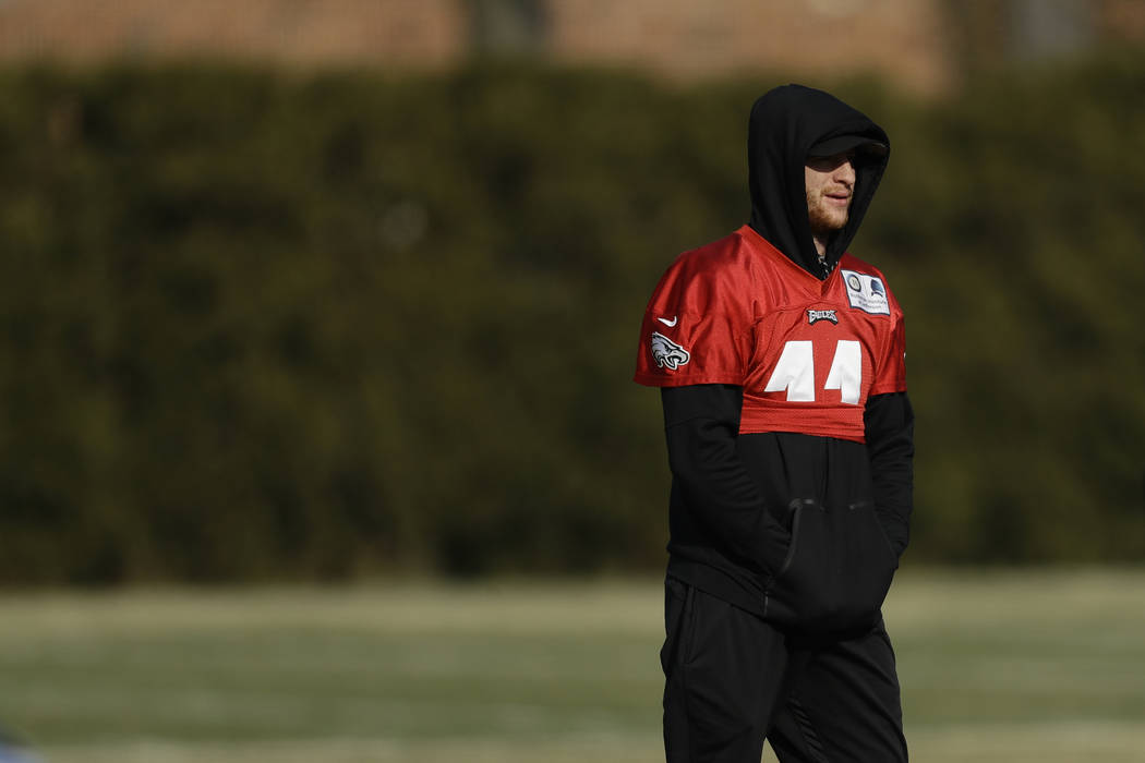 Philadelphia Eagles' Carson Wentz watches practice at the NFL football team's facility, Thursday, Dec. 13, 2018, in Philadelphia. (AP Photo/Matt Slocum)