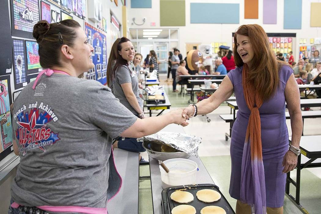 Henderson Mayor Debra March, right, shakes hands with third-grade teacher Katheryn Dubois as she greets teachers and staff at Josh Stevens Elementary School as part of Teacher Appreciation Week in ...