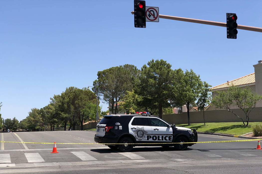 Las Vegas police investigate at the scene of a shooting in a home near Sahara Avenue and Hualapai Way, Thursday, May 24, 2018. (K.M. Cannon/Las Vegas Review-Journal)