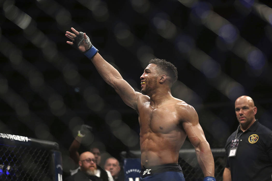 Kevin Lee celebrates his win over Edson Barboza after their fight was stopped in the fourth round of their mixed martial arts featherweight bout, early Sunday, April 22, 2018, in Atlantic City, N. ...