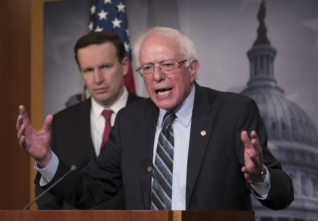 Sen. Bernie Sanders, I-Vt., joined at left by Sen. Chris Murphy, D-Conn., holds a news conference after the Senate passed a resolution he introduced that would pull assistance from the Saudi-led w ...