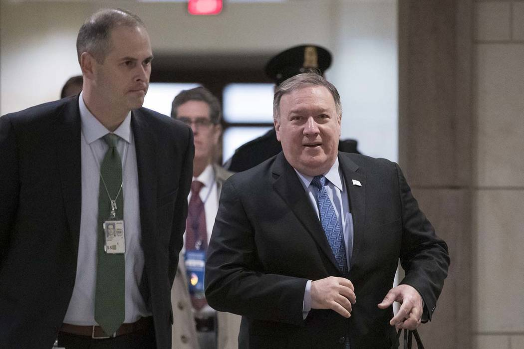 Secretary of State Mike Pompeo arrives to give House members a classified security briefing on the murder of Jamal Khashoggi and Saudi Arabia's war in Yemen, on Capitol Hill in Washington, Thursda ...