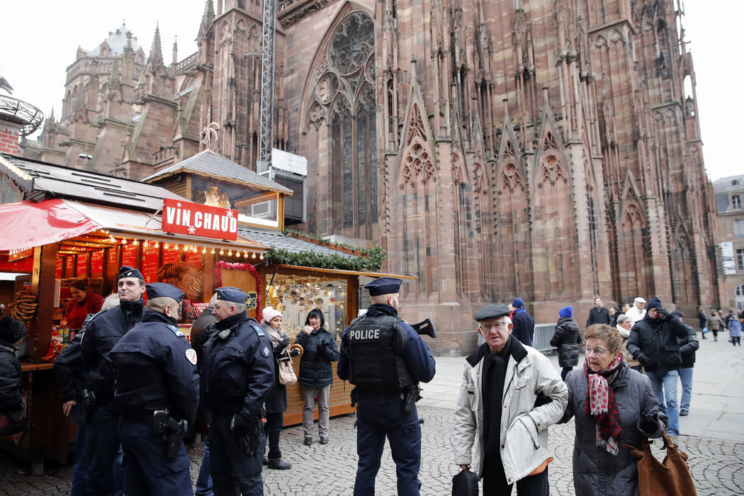 French police officers patrol outside the cathedral as the Christmas market reopens in Strasbourg, eastern France, Friday, Dec.14, 2018. The man authorities believe killed three people during a ra ...