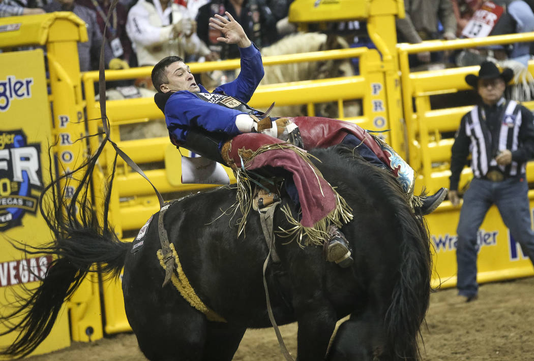Caleb Bennett of Tremonton, Utah (6) competes in the bareback riding event during the ninth go-round of the National Finals Rodeo at the Thomas & Mack Center in Las Vegas, Friday, Dec. 14, 201 ...
