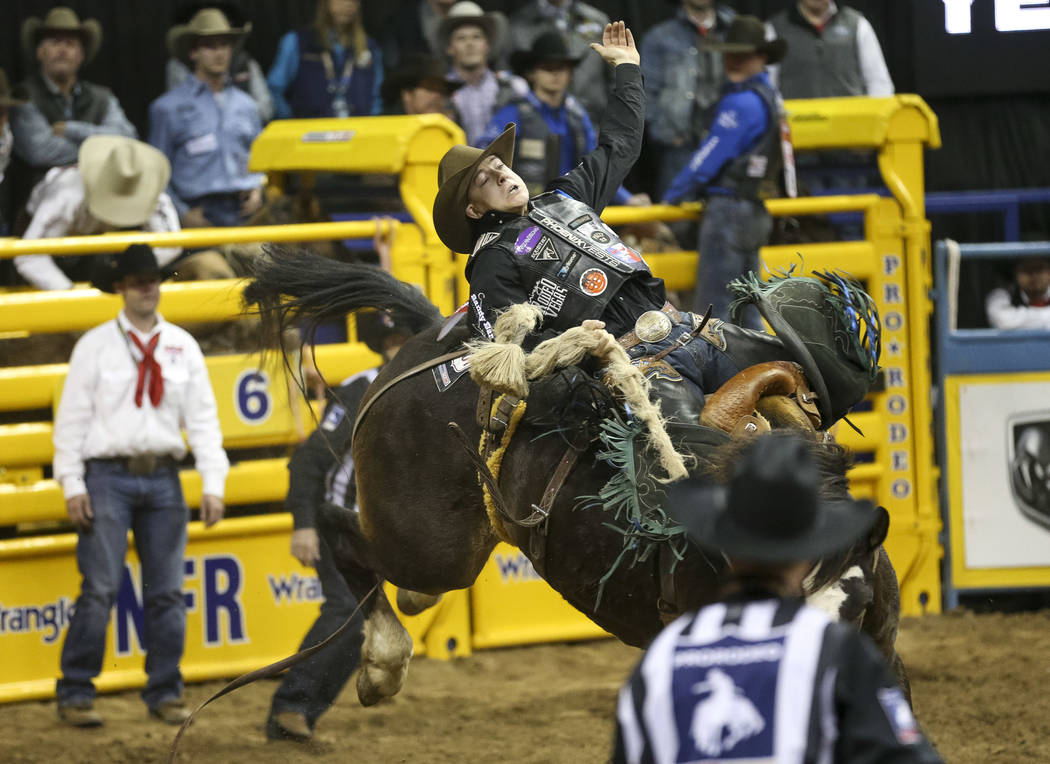 Zeke Thurston of Alberta, Canada (42) competes in the saddle bronc riding event during the ninth go-round of the National Finals Rodeo at the Thomas & Mack Center in Las Vegas, Friday, Dec. 14 ...