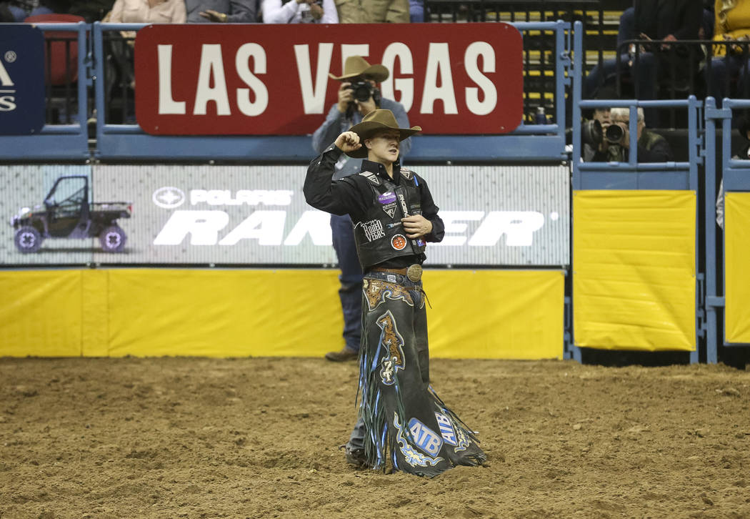 Zeke Thurston of Alberta, Canada (42) reacts after competing in the saddle bronc riding event during the ninth go-round of the National Finals Rodeo at the Thomas & Mack Center in Las Vegas, F ...