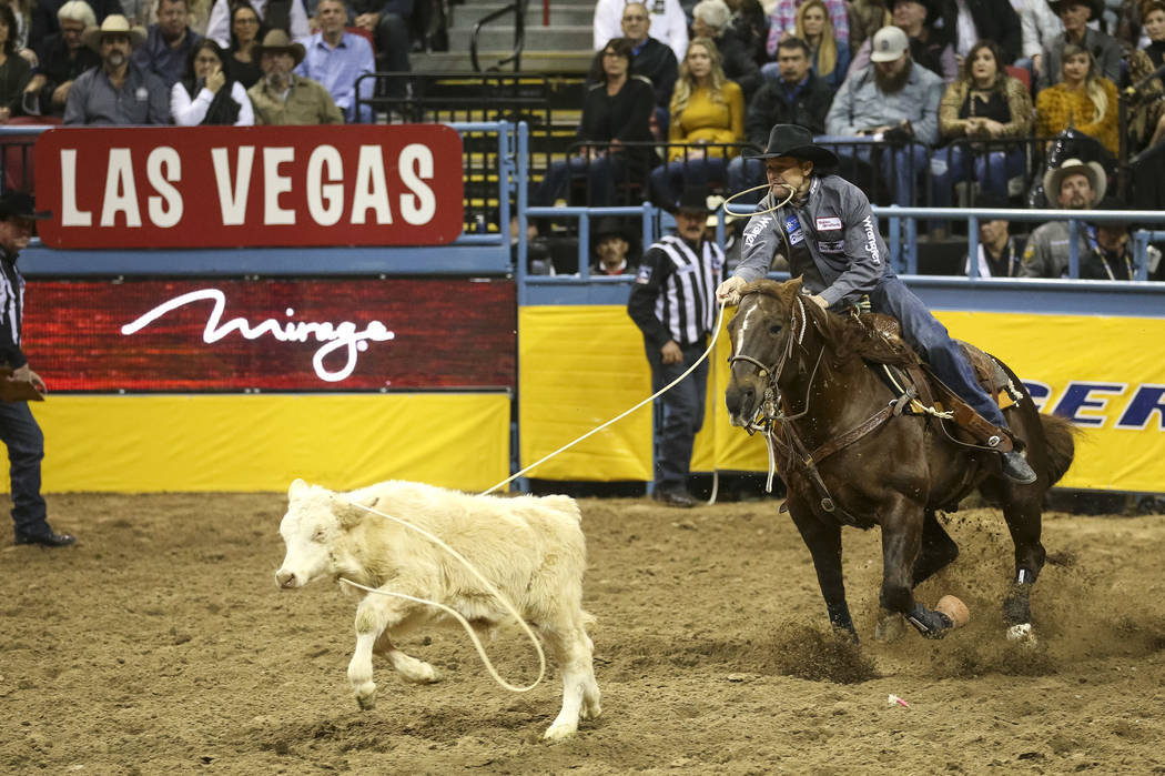 Sterling Smith of Stephenville, Texas (89) competes in the tie-down roping event during the ninth go-round of the National Finals Rodeo at the Thomas & Mack Center in Las Vegas, Friday, Dec. 1 ...