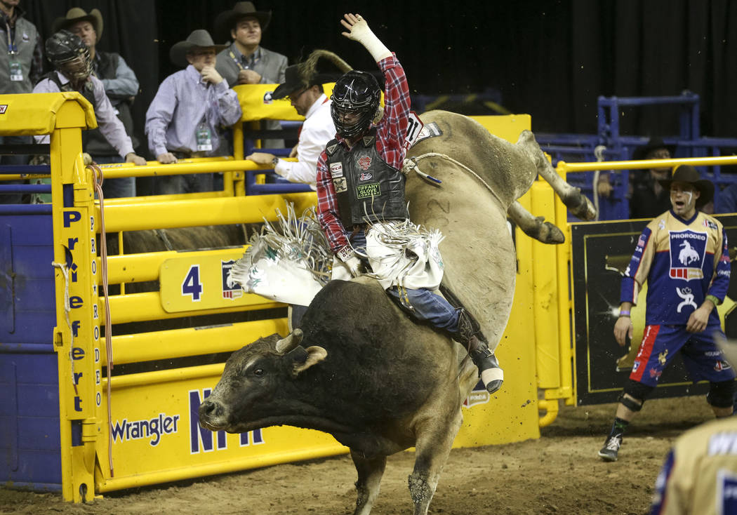 Eli Vastbinder of Union Grove, N.C. (105) competes in the bull riding event during the ninth go-round of the National Finals Rodeo at the Thomas & Mack Center in Las Vegas, Friday, Dec. 14, 20 ...