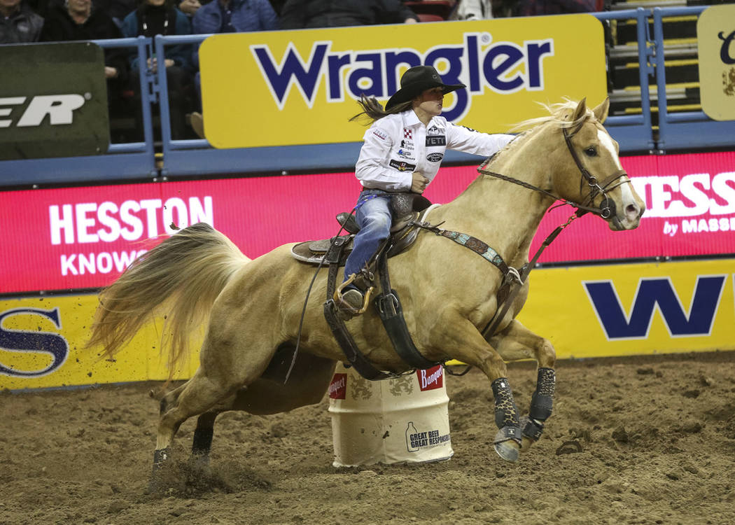 Hailey Kinsel of Cotulla, Texas (53) competes in the barrel racing event during the ninth go-round of the National Finals Rodeo at the Thomas & Mack Center in Las Vegas, Friday, Dec. 14, 2018. ...