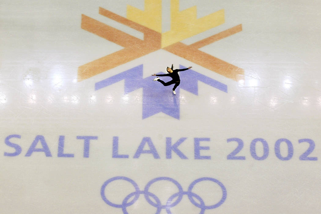 Shows U.S. champion Michelle Kwan practicing for the women's short program for the Winter Olympic Games at the Salt lake Ice Center in Salt Lake City on Feb. 8, 2002. Salt Lake City got the green ...