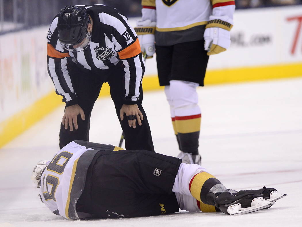 Vegas Golden Knights center Erik Haula (56) lies on the ice after taking a hit along the boards during the third period of an NHL hockey game against the Toronto Maple Leafs on Tuesday, Nov. 6, 20 ...