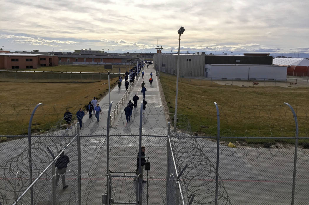 FILE - In this Jan. 30, 2018 file photo, inmates walk across the grounds of the Idaho State Correctional Institution in Kuna, Idaho. Idaho transgender inmate Adree Edmo has spent most of her priso ...
