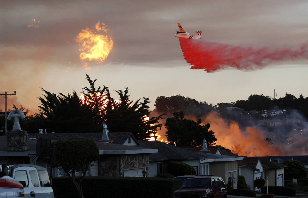 FILE - In this Sept. 9, 2010, file photo, a massive fire following a pipeline explosion roars through a mostly residential neighborhood in San Bruno, Calif. The California Public Utilities Commiss ...