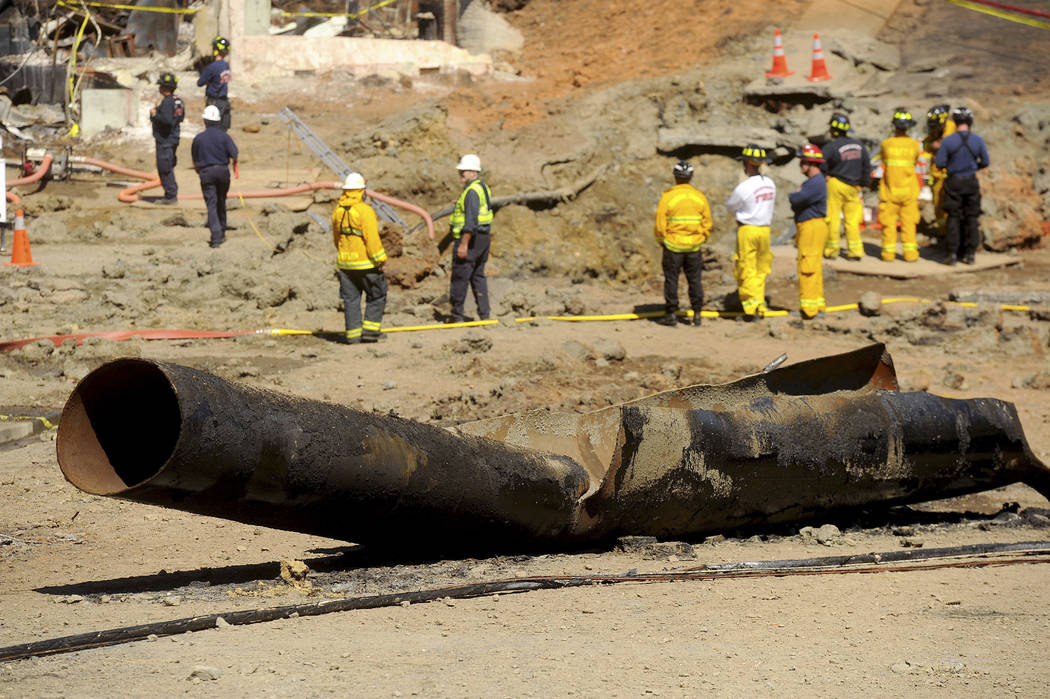 FILE - In this Sept. 11, 2010, file photo, a natural gas line lies broken on a San Bruno, Calif., road after a massive explosion. The California Public Utilities Commission said Friday, Dec. 14, 2 ...