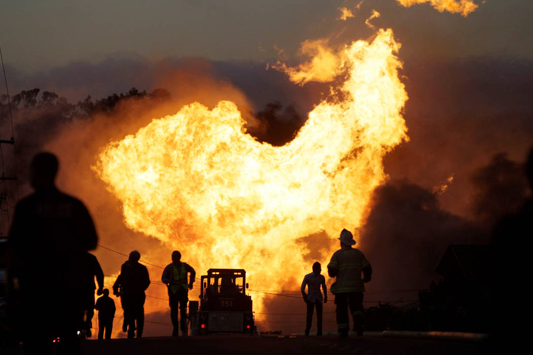 FILE - In this Sept. 9, 2010, file photo, a massive fire from a pipeline explosion roars through a neighborhood in San Bruno, Calif. The California Public Utilities Commission said Friday, Dec. 14 ...