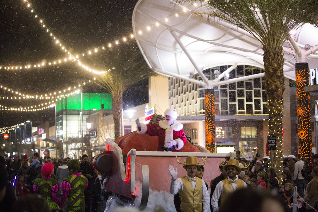Santa waves to the crowd during the Downtown Summerlin Holiday Parade on Festival Plaza Drive on Friday, Dec. 14, 2018, in Las Vegas. The parade features floats, dancers and festive holiday charac ...