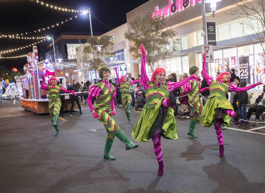 Dancers perform during the Downtown Summerlin Holiday Parade on Festival Plaza Drive on Friday, Dec. 14, 2018, in Las Vegas. The parade features floats, dancers and festive holiday characters and ...
