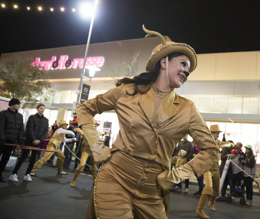 Performers dazzle the crowd as the Downtown Summerlin Holiday Parade makes its way through Festival Plaza Drive on Friday, Dec. 14, 2018, in Las Vegas. The parade features floats, dancers and fest ...