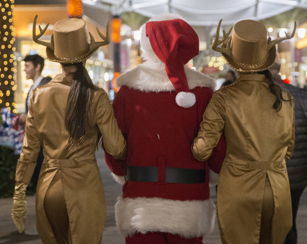 Santa makes his way to the chalet to greet children at the conclusion of the Downtown Summerlin Holiday Parade on Friday, Dec. 14, 2018, in Las Vegas. The parade features floats, dancers and festi ...
