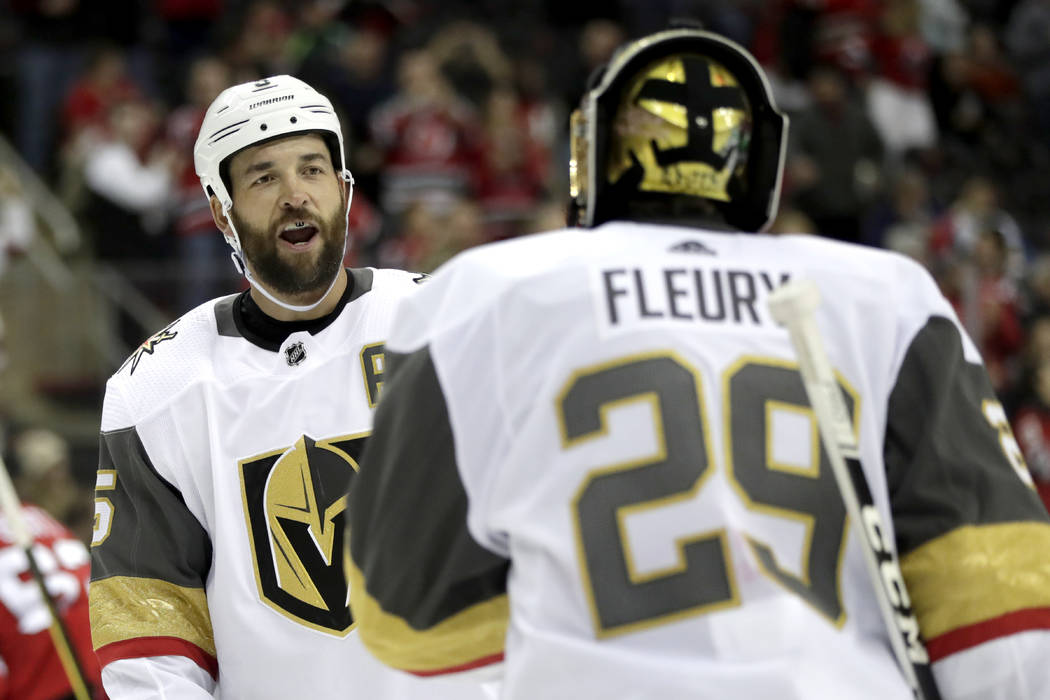 Vegas Golden Knights defenseman Deryk Engelland, left, talks to goaltender Marc-Andre Fleury (29) after they allowed a goal to New Jersey Devils center Travis Zajac during the second period of an ...