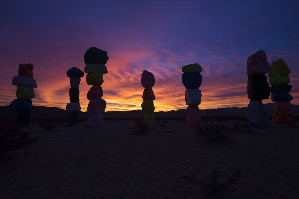 A cotton candy sunrise is seen over the Seven Magic Mountains art installation near Jean Dry Lake early Friday morning, Dec. 14, 2018. Richard Brian Las Vegas Review-Journal @vegasphotograph