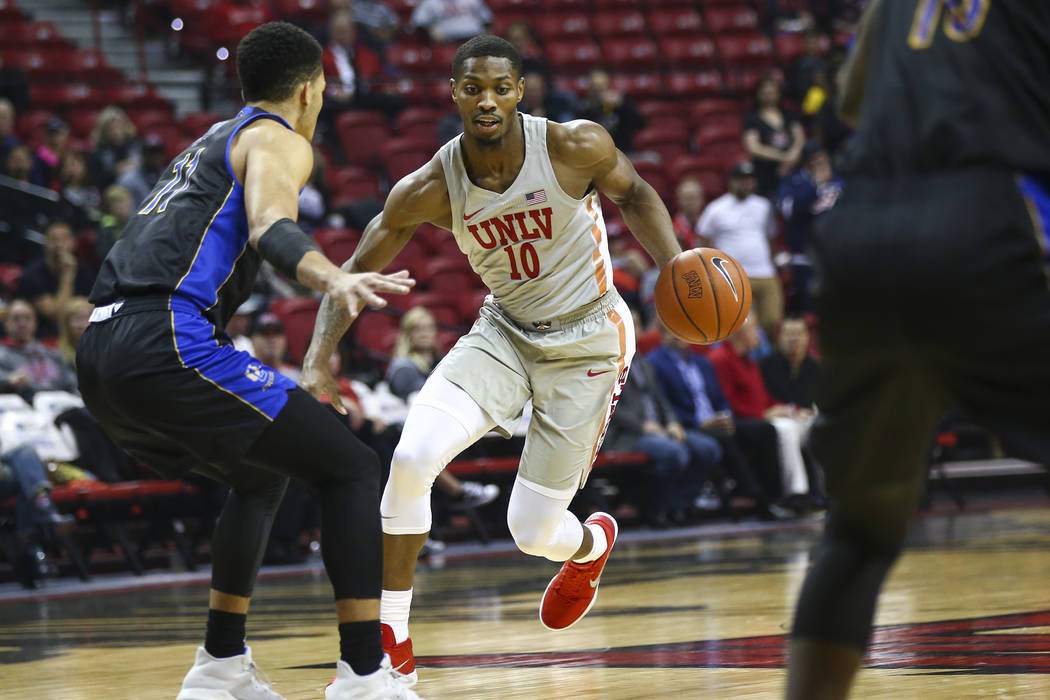 UNLV Rebels forward Shakur Juiston (10) brings the ball up court as UC Riverside Highlanders forward Zac Watson (11) defends during the first half of a basketball game at the Thomas & Mack Cen ...