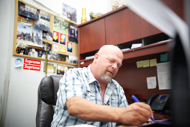 "Rick Harrison of the reality TV show ""Pawn Stars"" signs autographs at Gold & Silver Pawn shop in downtown Las Vegas on Thursday, July 17, 2014. (Chase Stevens/Las Vegas Review-Journal)"