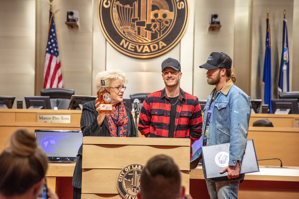 Las Vegas Mayor Carolyn Goodman accepts a bottle of Old Camp Whiskey from Tyler Hubbard and Brian Kelley of Florida Georgia Line at City Hall she proclaims Dec. 11, 2018 Florida Georgia Line Day ...