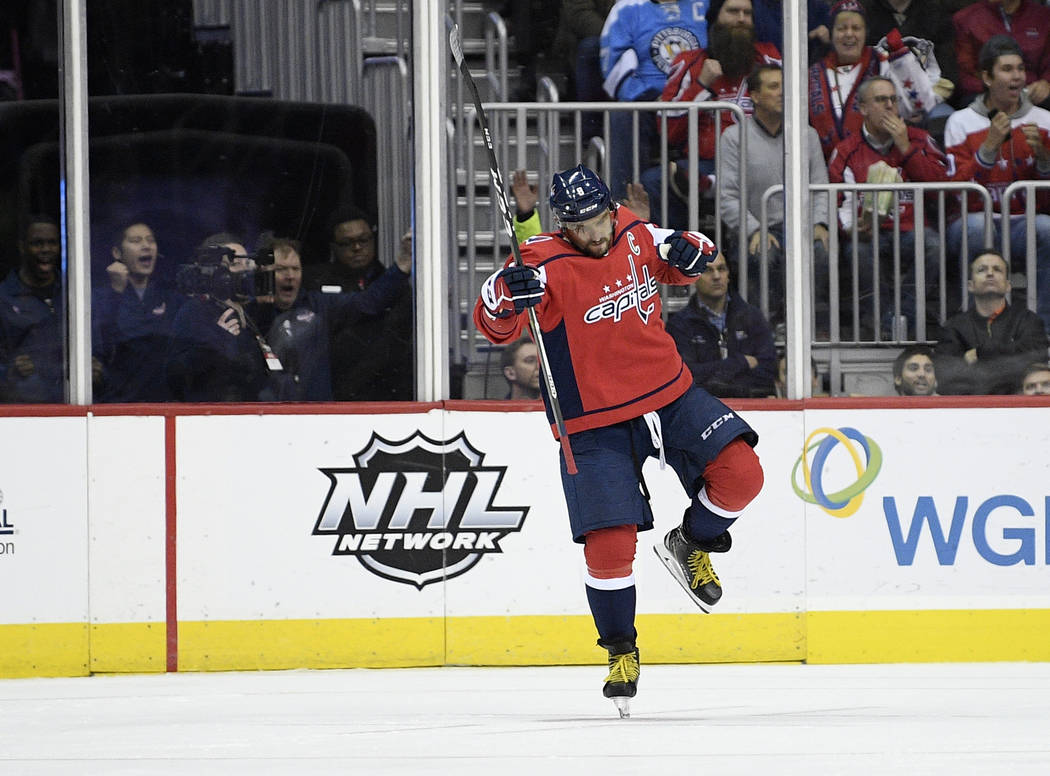 Washington Capitals left wing Alex Ovechkin (8), of Russia, celebrates his goal during the second period of an NHL hockey game against the Pittsburgh Penguins, Wednesday, Nov. 7, 2018, in Washingt ...