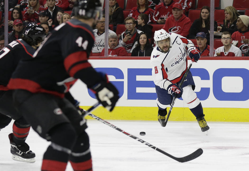 Washington Capitals' Alex Ovechkin (8) shoots and scores against the Carolina Hurricanes during the first period of an NHL hockey game in Raleigh, N.C., Friday, Dec. 14, 2018. (AP Photo/Gerry Broome)