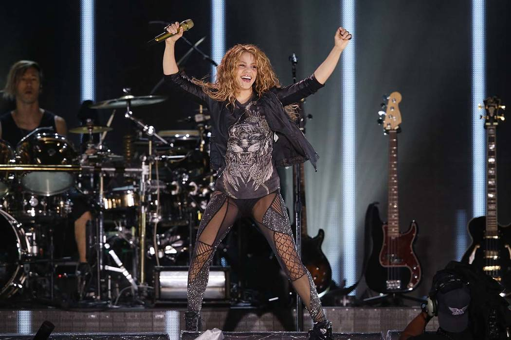 FILE - In this Oct. 11, 2018 file photo, Shakira performs at Azteca Stadium in Mexico City, Spanish prosecutors charged the Colombian singer with tax evasion on Friday, Dec. 14, 2018, alleging she ...