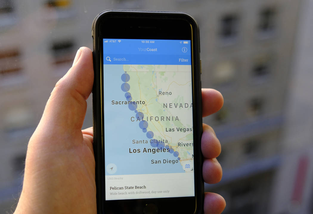 The new YourCoast app is displayed on a smartphone Thursday, Dec. 13, 2018, in San Francisco. (AP Photo/Eric Risberg)