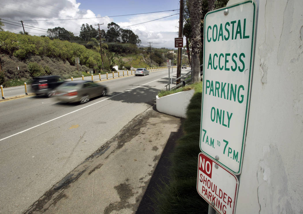 In this April 20, 2007 file photo a sign directing visitors to two parking spaces next at a coastal access gate for Escondido Beach is shown on Pacific Coast Highway in Malibu, Calif. (AP Photo/Re ...