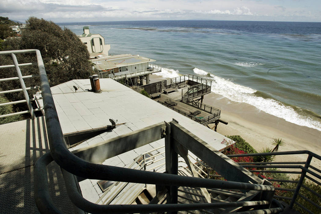 In this April 20, 2007 file photo beachgoers have this view of public beach and private residences from the top of a stairway access to Escondido Beach in Malibu, Calif. (AP Photo/Reed Saxon,File)
