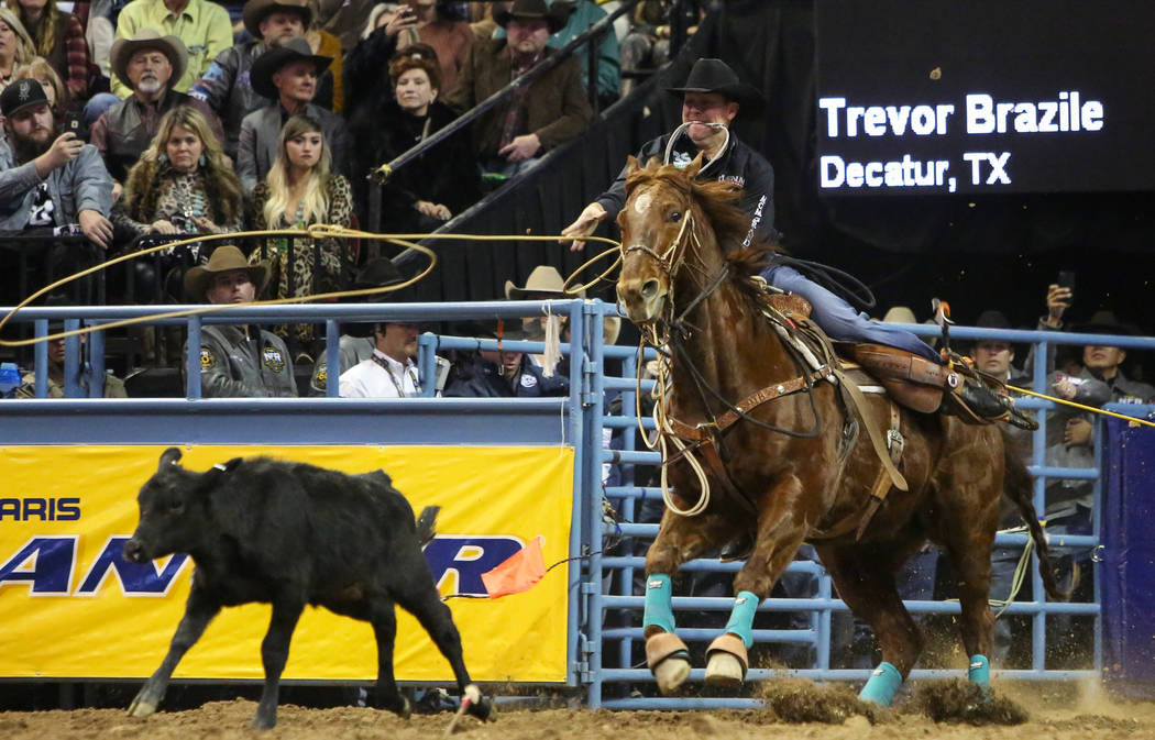 Trevor Brazile of Decatur, Texas (2) competes in tie-down roping during the tenth go-round of the National Finals Rodeo at the Thomas & Mack Center in Las Vegas, Saturday, Dec. 15, 2018. Carol ...