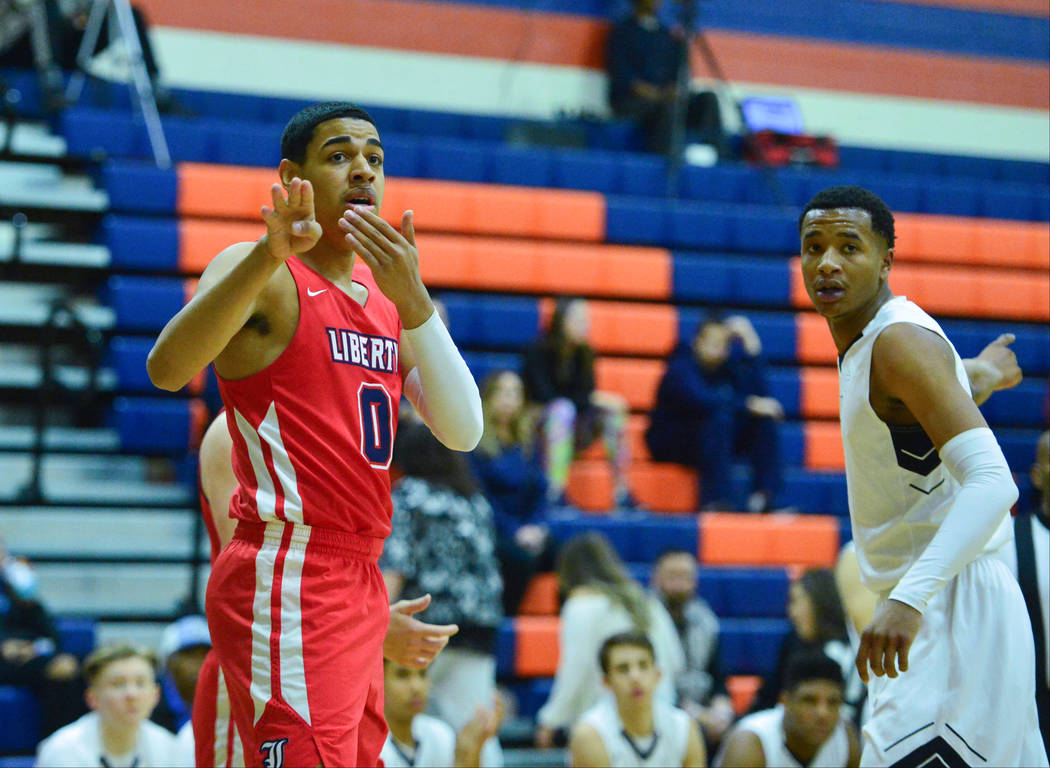 Liberty's Julian Strawther (0) tries to persuade a referee for possession on an out of bounds call in the first quarter of the game between Liberty High School and Faith Lutheran at Bishop Gorman ...