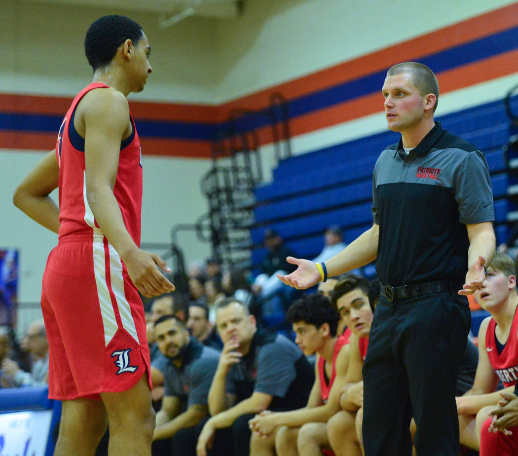 Liberty head coach Stefan Berg talks to Kobe Stroughter (1) the second quarter of a game between Liberty High School and Faith Lutheran at Bishop Gorman High School in Las Vegas on Saturday, Dec. ...
