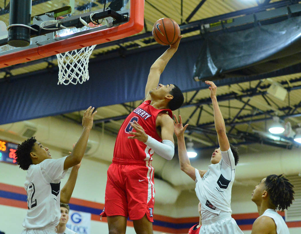 Liberty's Julian Strawther (0) rebounds the ball in the second quarter of the game between Liberty High School and Faith Lutheran at Bishop Gorman High School in Las Vegas on Saturday, Dec. 15, 20 ...