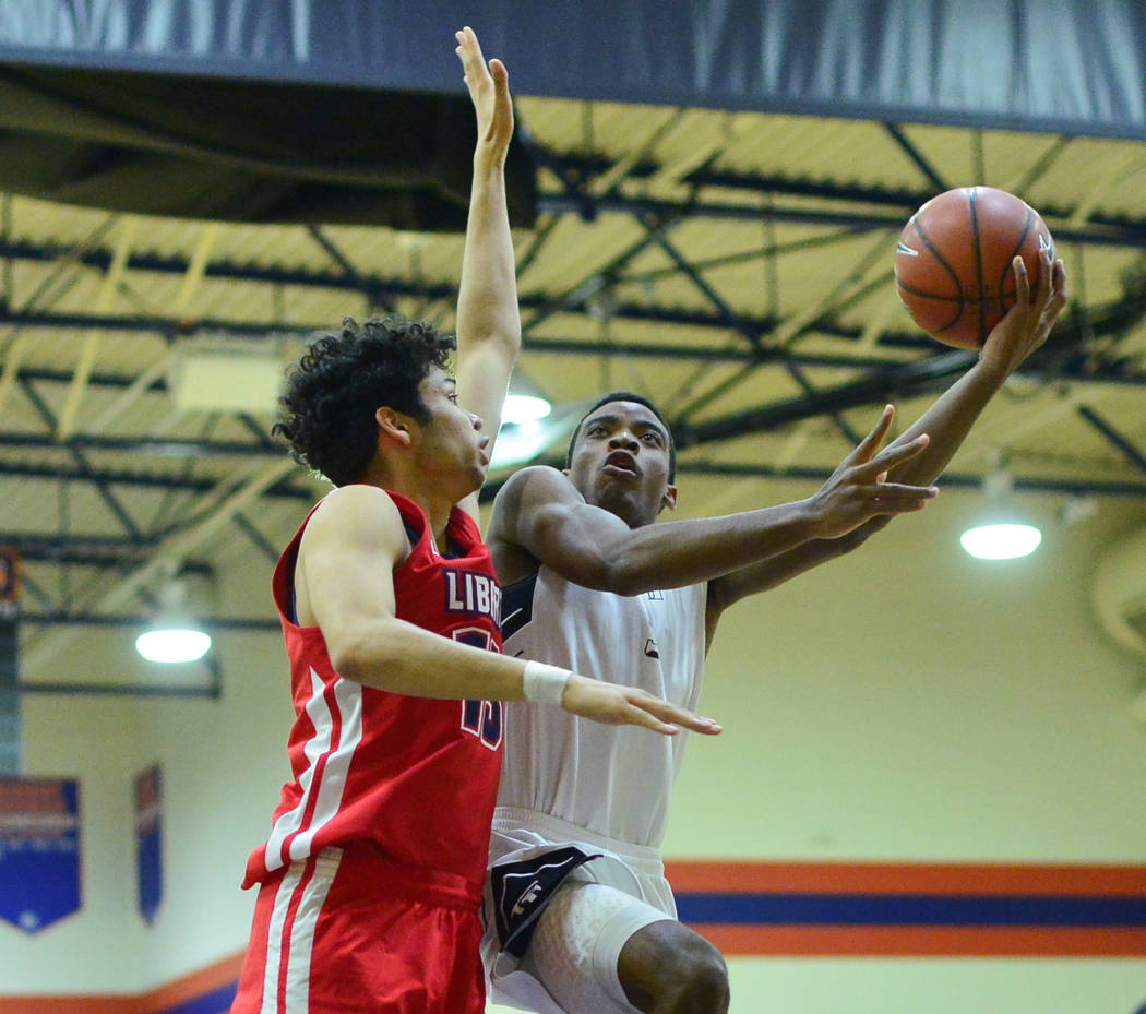 Faith Lutheran's Azavier Johnson (5) shoots the ball during a game between Liberty High School and Faith Lutheran at Bishop Gorman High School in Las Vegas on Saturday, Dec. 15, 2018. Faith Luther ...