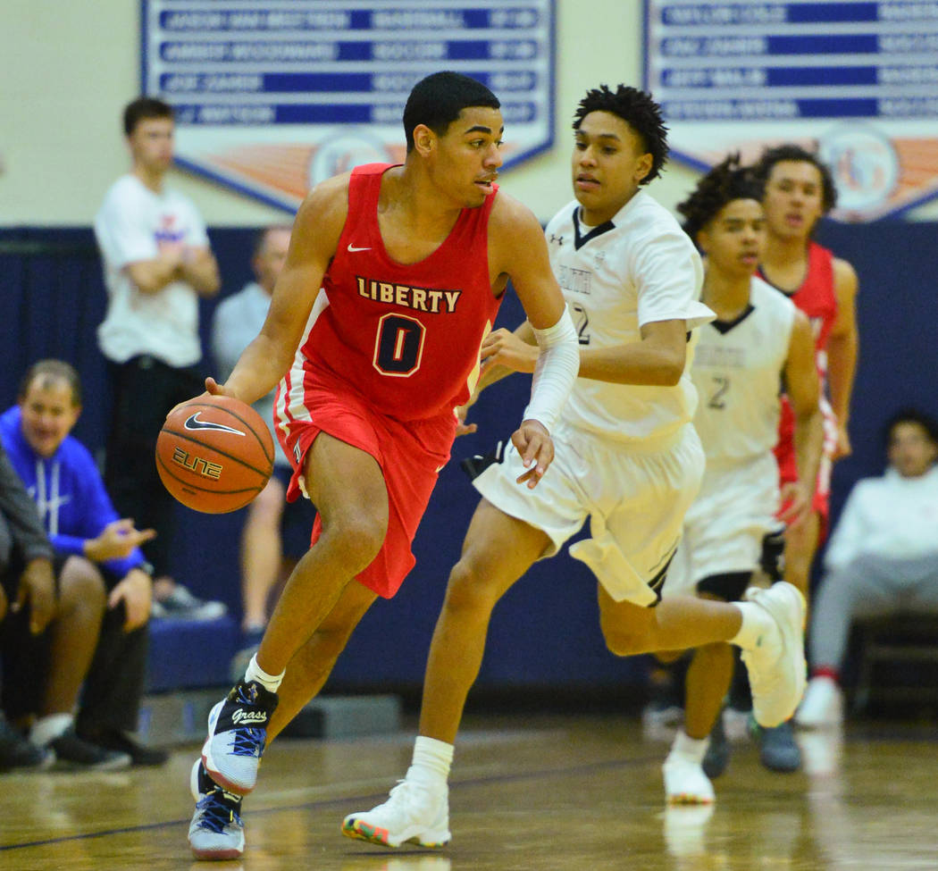 Liberty's Julian Strawther (0) dribbles the ball down the court during the second quarter of the game between Liberty High School and Faith Lutheran at Bishop Gorman High School in Las Vegas on Sa ...