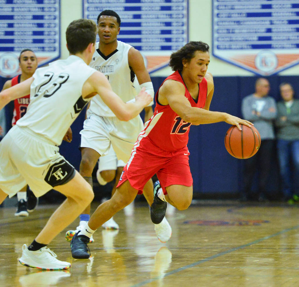 Liberty's Victor Epstein(12) dribbles the ball between Faith Lutheran defenders during a game between Liberty High School and Faith Lutheran at Bishop Gorman High School in Las Vegas on Saturday, ...