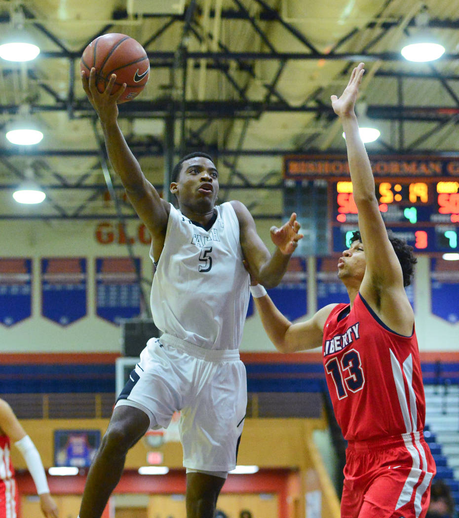 Faith Lutheran's Azavier Johnson (5) shoots the ball over Liberty's Terrance Marigney (13) during a game between Liberty High School and Faith Lutheran at Bishop Gorman High School in Las Vegas on ...