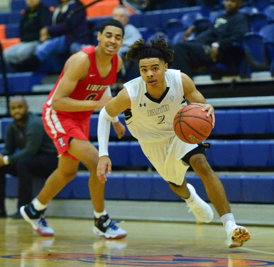 Faith Lutheran's Donavan Jackson (2) dribbles the ball past Liberty's Julian Strawther (0) during a game between Liberty High School and Faith Lutheran at Bishop Gorman High School in Las Vegas on ...