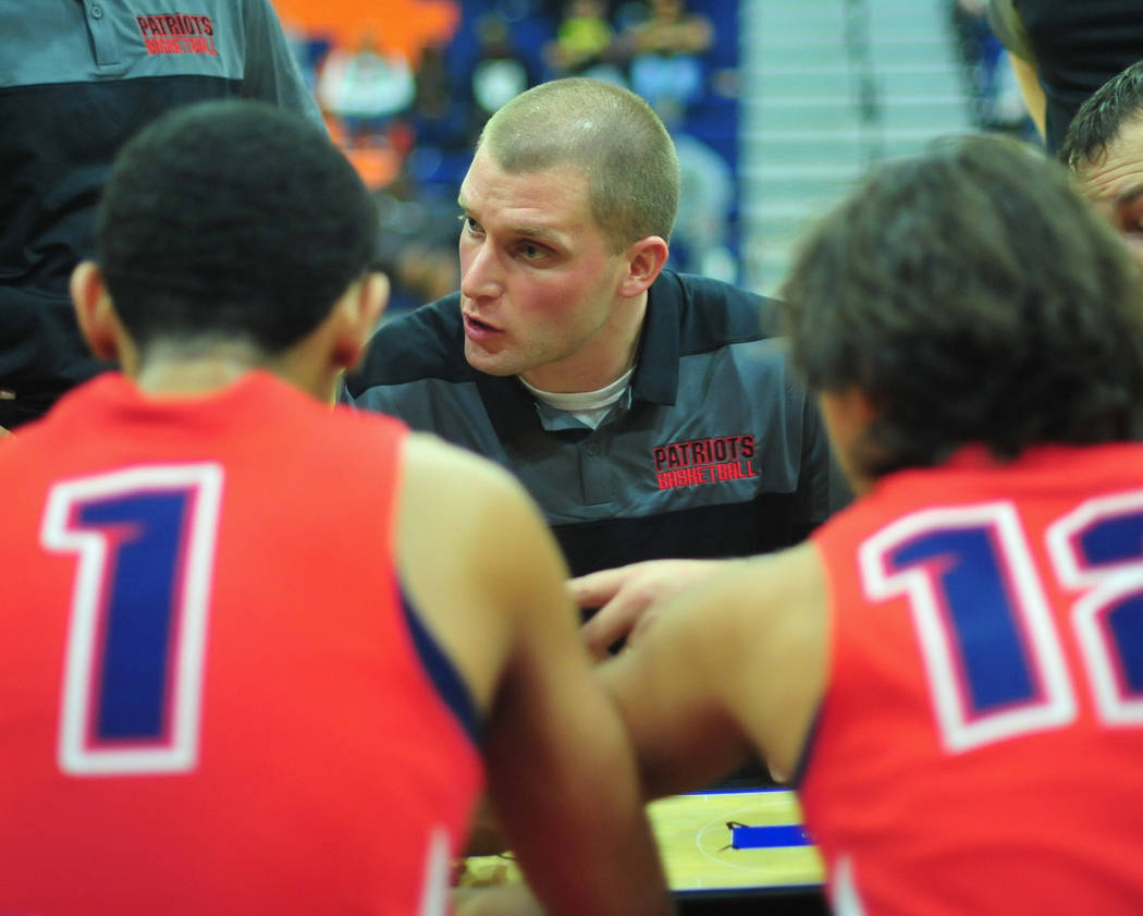 Liberty head coach Stefan Berg talks to his team during a time out in a game between Liberty High School and Faith Lutheran at Bishop Gorman High School in Las Vegas on Saturday, Dec. 15, 2018. Fa ...