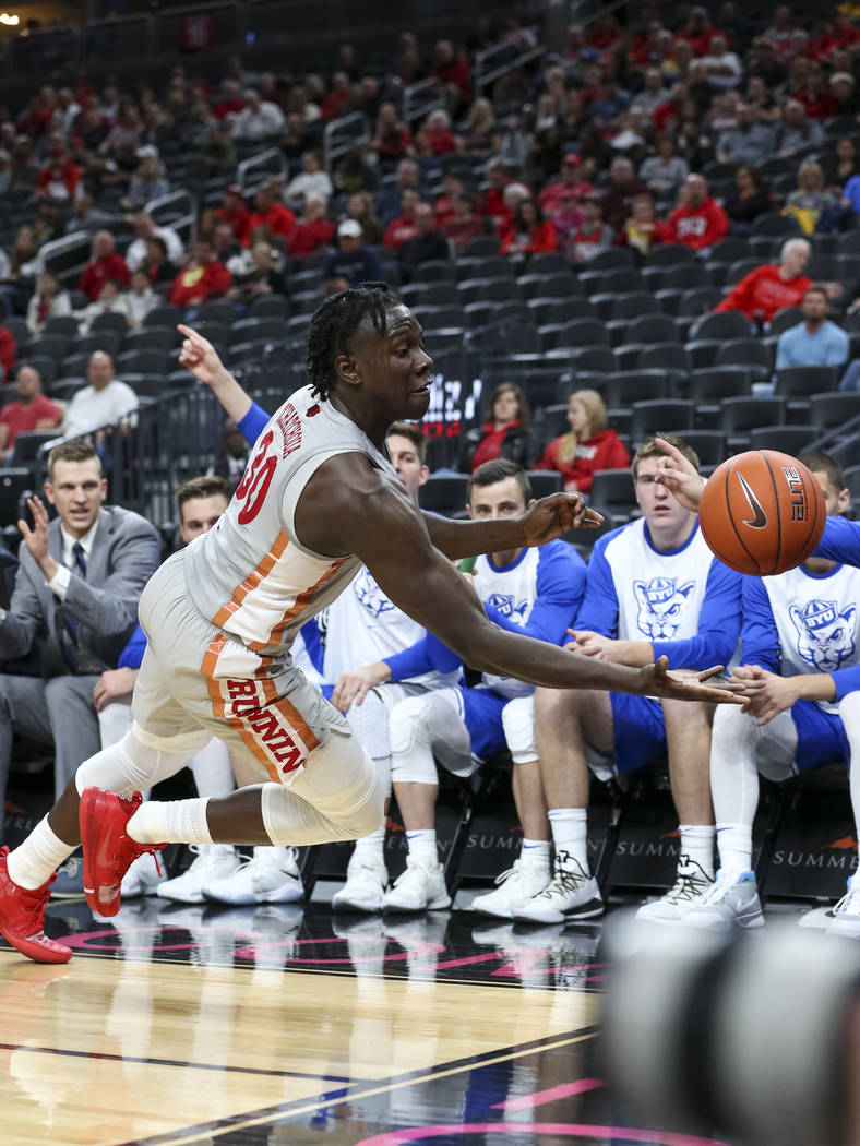 UNLV Rebels forward Jonathan Tchamwa Tchatchoua (30) tries to save the ball from going out of bounds during the first half of an NCAA college basketball game against the Brigham Young Cougars at T ...